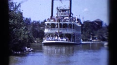 1959: retro video of a steamboat ferry full of people on a river DISNEYLAND Stock Footage