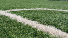 Close up of the out of bounds line on a turf football field Stock Footage