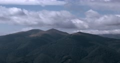 Running Clouds With Mountain Range and Trees Timelapse. Carpathian Mountains Stock Footage