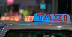 Close up view of taxi sign on cabs waiting people. Hong Kong, China Stock Footage