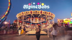 Toronto CNE The Ex Sunset Fair Crowds Rides Games Festival Alpine Bobs Stock Footage