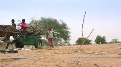Heat African savanna landscape - cart and local people in the background Stock Footage
