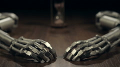 Hourglass and two robot arms. Dolly slider shot Stock Footage