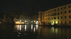 The dinamic view on night venice architecture from moviing gondola boat Stock Footage