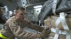 A U.S. Air Force crew prepares a C-17 Globemaster for an airdrop mission. Stock Footage