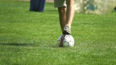 Football player kicking ball on a field, slow motion Stock Footage