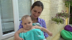 Mom keeps a small child in her arms Stock Footage