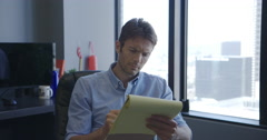 Business men writing and passing notes in Downtown LA office 4K Stock Footage