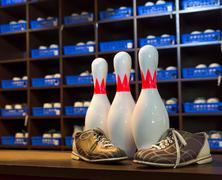 Bowling shoes and pins Stock Photos