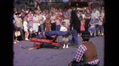 1962: stiff guy wheeled away on wheelbarrow. SAN PEDRO, CALIFORNIA Stock Footage