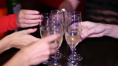 Beautiful girl at a party celebrating the birthday with glasses of champagne in Stock Footage