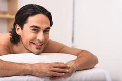 Relaxed man smiling at camera Stock Photos