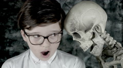 4k Science Shot of a Boy in Laboratory Scared by a Skeleton  Stock Footage