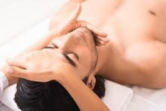 Professional masseuse doing facial massage Kuvituskuvat