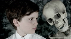 4k Science Shot of a Boy in Laboratory Posing with a Skeleton Stock Footage