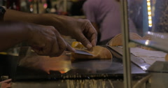 Street vendor cooking dessert Kanom Buang in Bangkok, Thailand Stock Footage