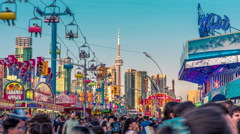 Toronto CNE The Ex Sunset Fair Crowds Rides Games Festival CN Tower Time-lapse 2 Stock Footage