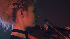 Retro Caucasian girl musician with Mohican hairstyle playing the violin Stock Footage