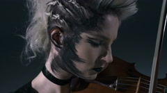 Gothic style Caucasian girl musician with make up playing the violin Stock Footage