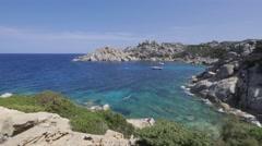 Rocky coastline on Cape Testa in Sardinia Stock Footage