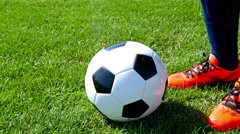 Soccer ball on the center point of a football field, player kicking the ball Stock Footage