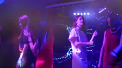 Beautiful girls dancing at a party - disco birthday Stock Footage