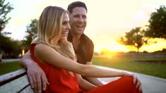 Attractive happy Caucasian couple enjoying romantic sunset Stock Footage