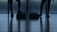 Silhouette of young fit multi ethnic couple running in fitness studio Stock Footage