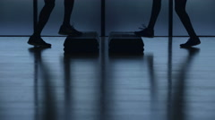 Silhouette of young multi ethnic couple enjoying running in gym Stock Footage