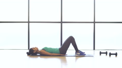 Young attractive fit Indian American female training in fitness studio Stock Footage