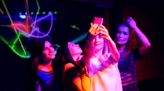 Beautiful girl at a party with your mobile make selfie - disco birthday Stock Footage