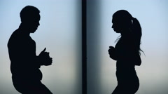 Silhouette of young multi ethnic couple enjoying running in fitness gym Stock Footage