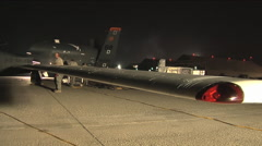 The RQ-4 drone surveillance aircraft is rolled out at night and prepared for a Stock Footage