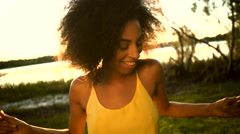 Cute African American female dancing on Summer holiday in park sun light Stock Footage