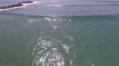 Aerial shot, surfer catching wave in beach Stock Footage