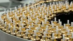 Bottles zip along a conveyor belt in a bottling plant. Stock Footage