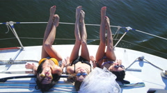 Beautiful girls sunbathing on a yacht - party and bachelorette party Stock Footage