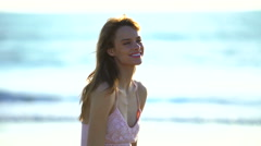 Young slim Caucasian American woman relaxing on beach Stock Footage