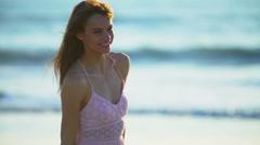 Cute Caucasian American woman enjoying Summer holiday beach Stock Footage