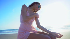 Young slim Caucasian American female relaxing on holiday beach Stock Footage