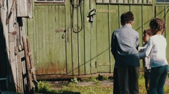 Children playing on street in countryside. Close girl in old barn. Game. Fun Stock Footage