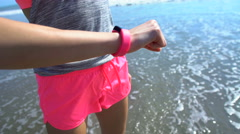 Active Caucasian American female training to keep fit on beach at sunrise Stock Footage