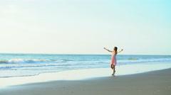 Cute Caucasian American woman enjoying holiday beach at sunrise Stock Footage