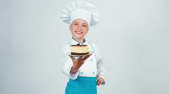Baker sniffing chocolate biscuit and gives you it. Chef 7-8 years smiling Stock Footage