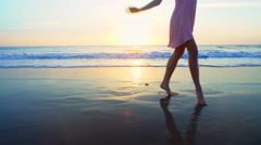 Cute Caucasian American woman posing on beach on vacation at sunset Stock Footage