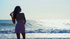 Slim Caucasian American female posing on beach on holiday in sunshine Stock Footage