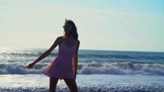 Hippie Caucasian American girl on leisure vacation beach Stock Footage