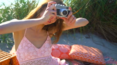 Portrait of Caucasian American woman taking picture at picnic on holiday beach Stock Footage