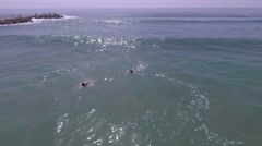 Aerial shot, surfer catching wave in beach surf Stock Footage
