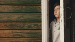 Mother open door walk out from country house on street with son. Countryside Stock Footage